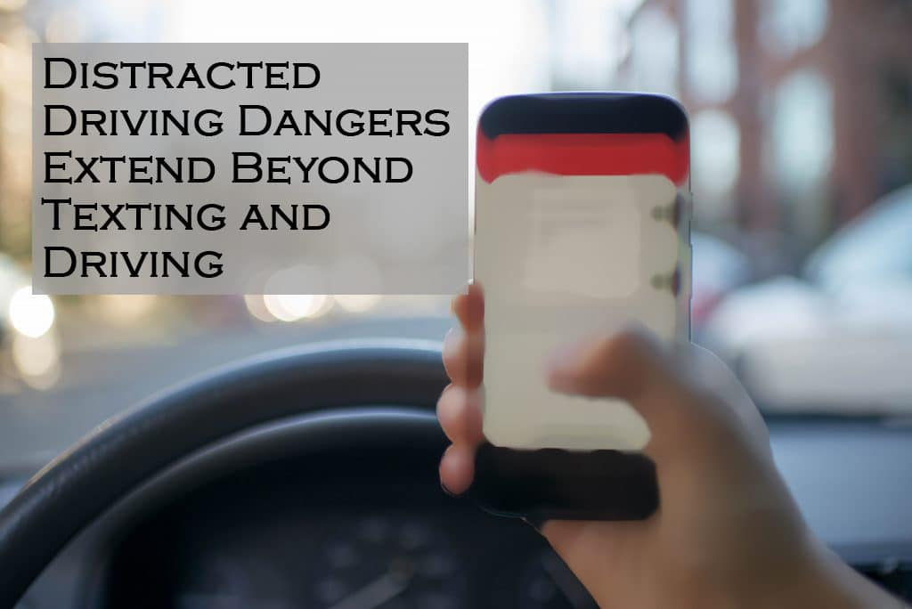 a hand holding a cell phone texting and driving - Warren, RI personal injury attorney Abilheira Law, LLC